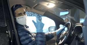 Uber driver with a mask and gloves